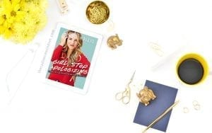 Flat Lay desktop image with Girl, Stop Apologizing by Rachel Hollis on it. This is a post of a book review for her newest book. www.theradiancemindset.com